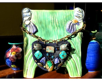 The MINI SHIELD NECKLACE by Gilded-Mane: Hand-Blown Glass, Turquoise, Agate & Oxidized Brass Tulips on Navy Fur and Reclaimed Leather, Small