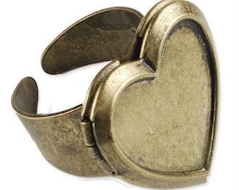An antique Bronze Heart Locket ring.
