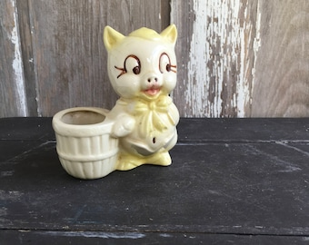 1950s vintage Shawnee pottery yellow pig planter