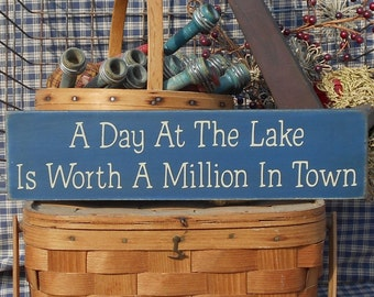 Primitive rustic A Day At The Lake Is Worth A Million In Town painted wood sign choice of color