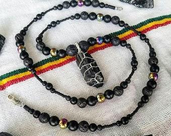 Black Tourmaline pendant on a Onyx, Hematite and Lavastone bead chain