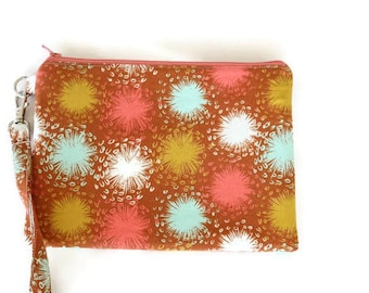 Brown floral bursts vegan women wristlet wallet clutch purse. Fits iPhone 8 and X. Brown, aqua, coral and mustard yellow.