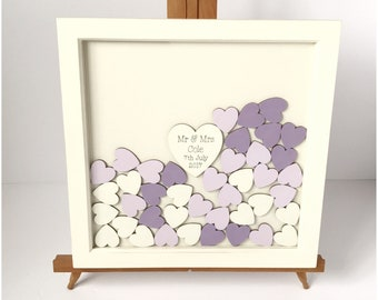 Purple drop top alternative wedding guest book with a white wood frame.
