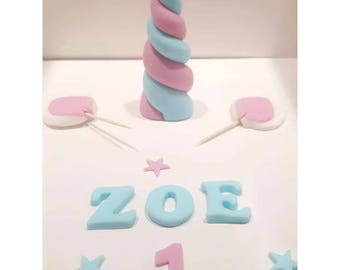 Pink and blue handmade edible unicorn cake topper set
