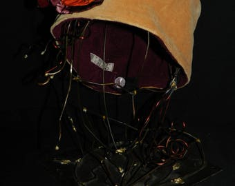 Hat in beige velvet and silk Burgundy orange flower.