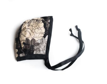 RTS 0-3M Bonnet | Black Floral with Polkadot on the reverse side