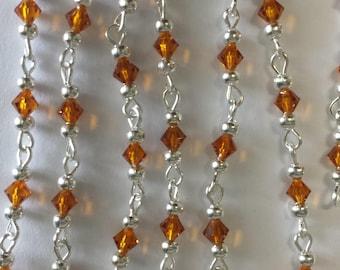 chain 55cm / 4mm dark Topaz glass bicone beads