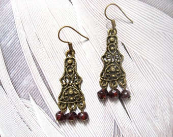Amisha earrings - antiqued brass finish filigree pendants with deep red garnet stone faceted beads