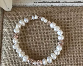 Fresh water pearl and rose gold beaded bracelet. Beads are approx. 7mm