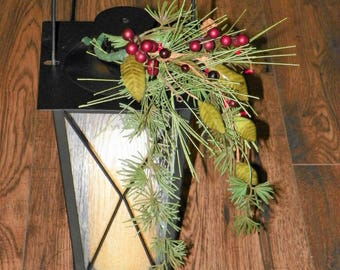 Black Lantern Complete with LED Timer Pillar Candle and Decorated with an Evergreens, Berries and Pine Cone Spray
