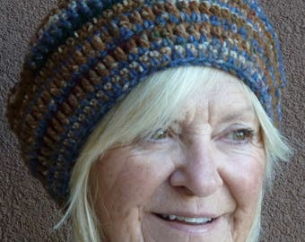 Women's winter hat in blue and brown, crochet beanie that's original and unique, warm and comfortable for the ski slopes, a gift for her