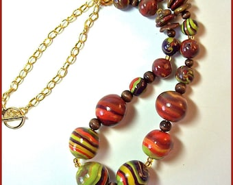 Earthy Reds and Greens Necklace 21 in. Polymer Clay Handcrafted  Yellow and Purple Accents