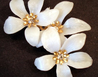 White Plastic Flower Brooch with Rhinestone Centers