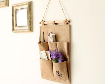 Grey wall storage,sack wall decoration,series hanging bags, containing debris,key storage bag