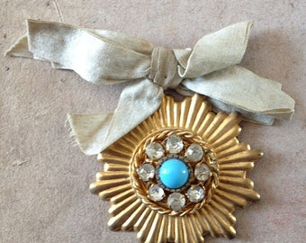 Vintage French Starburst Pendant Badge Turquoise colored diamante gold Cabaret Photography Prop