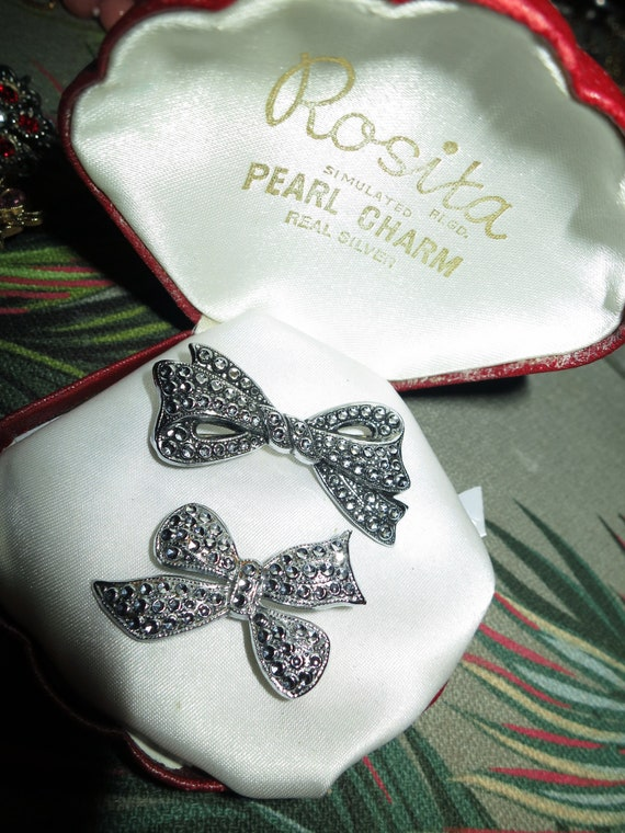 Beautiful pair of vintage fx marcasite staybrite bow brooches