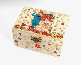 "Vintage jewelry box, musical - boy and girl with flowers, 60s, 70s, 1960s, 1970s, red interior with mirror, plays ""Raindrops Keep Fallin"""