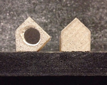 Magnets houses from concrete
