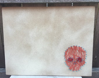 Cork Board with String Skull Accent