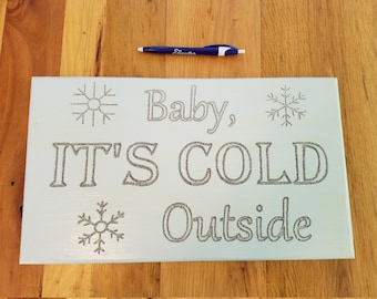 Christmas sign Baby its cold outside