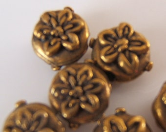 Round Lentil Shaped Beads w/ Flower Pattern in an Antiqued Brass Finish