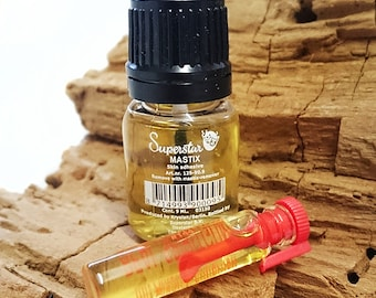 Mastix, Spirit Gum. Make-up glue. Not for individual sale.