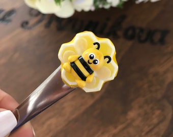 Tea spoon with adorable kawaii honey bee