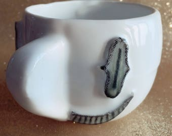 Small coffee/ tea cup. 5cmx5cm