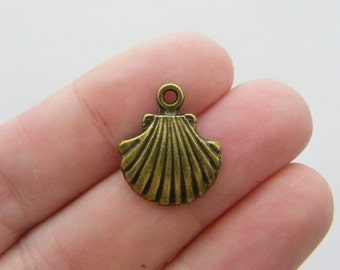 10 Shell charms antique bronze tone BC2