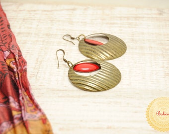 Earrings in bronze and drop glazed red.