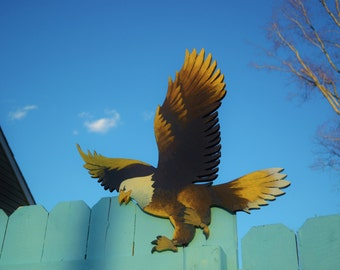 The Eagle has Landed.  Lawn art, yard decorations. Birds.