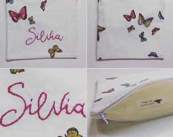Custom woven clutch bag with hand embroidery