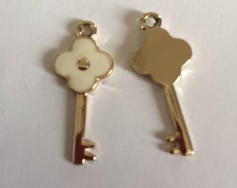 White enamel and gold key
