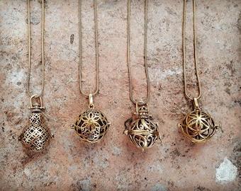 Boho brass necklace with bell inside, mandala prints Gypsy necklace.