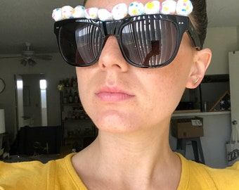 Paint-splattered puffball sunglasses