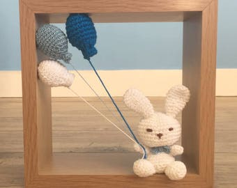 Rabbit and his balloons to the handmade crochet. Craft creation.