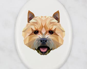 A ceramic tombstone plaque with a Norwich Terrier dog. Art-Dog geometric dog