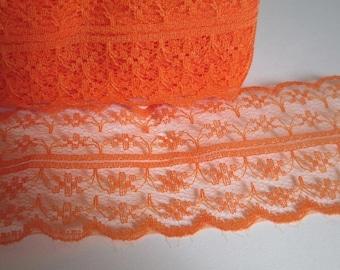 1 meter Ribbon lace orange fine lined 40mm