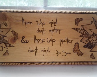 Pine woodburned sign with Dr. Seuss quote.