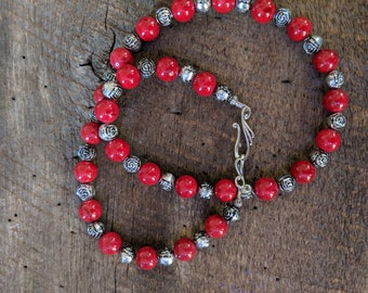 Red glass bead and silver tone rosette necklace and earring set