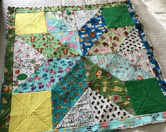 Play Blanket.  Handmade. Flannel front, twill back.  Animal themed front, star design