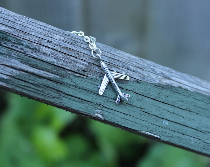 Fly away with me, Tiny Aeroplane silver necklace.