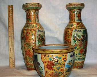 Listing 131 is the Handpainted 3pc set of asian moriage style vases
