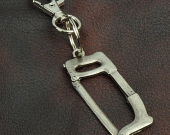 Hack Saw key Chain ,  zinc cast and plated, sold by each