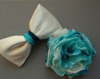 Wedding accessories for him and her, bow tie and flower brooch.