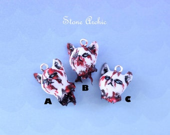 Bloody cat head charms