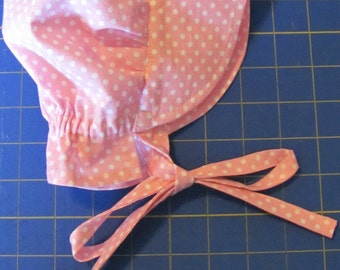 12 months pink dot baby bonnet
