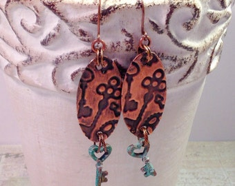 Steampunk key charm earrings, embossed copper with patina key charm
