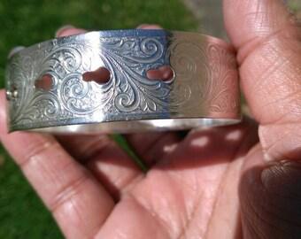 Adjustable vintage bangle.