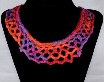 Necklace and earrings, crocheted using multi-color orange, pink and purple stretch cotton yarn with gold clasp.  Handmade